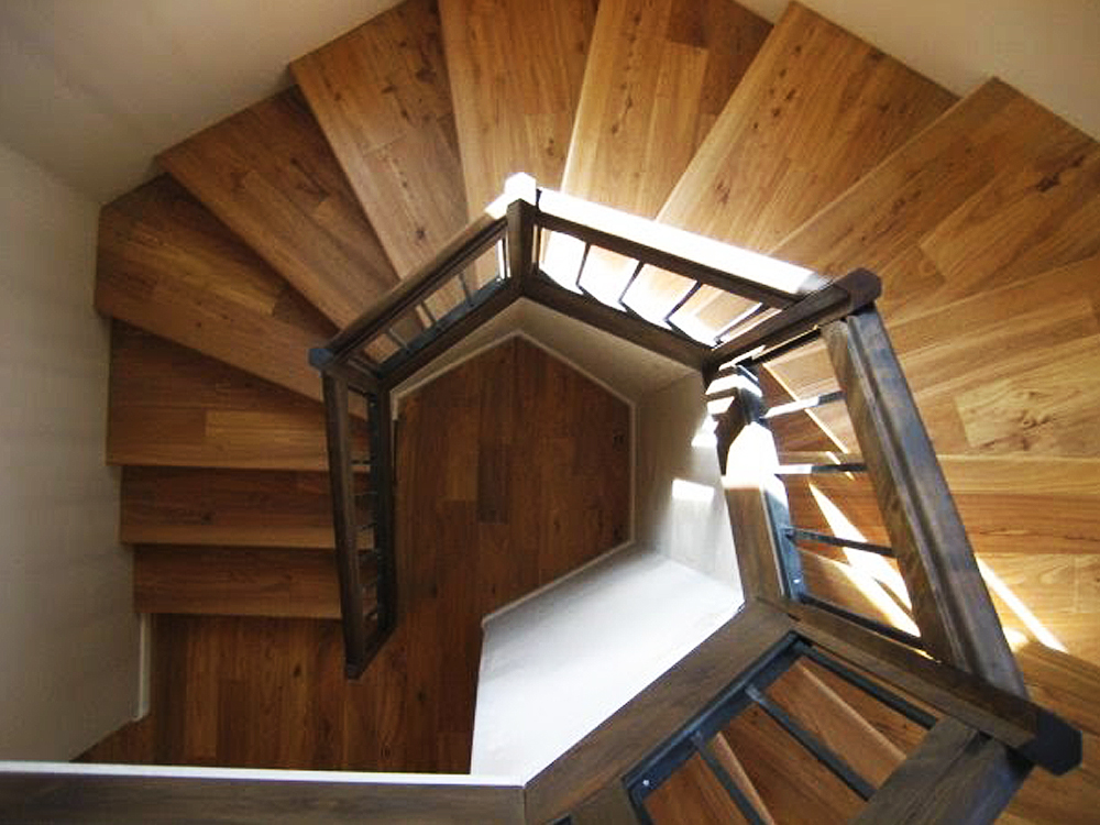 Light Brown Hard Wood Floors Installed On Spiral Stairs